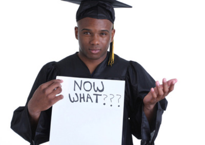 """A Graduate Student with a placard : """" Now what"""" sign"""