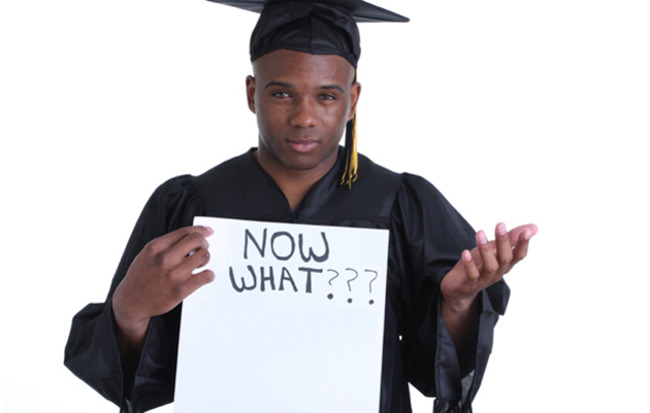 "A Graduate Student with a placard : "" Now what"" sign"